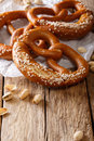 Traditional pretzel with salt and pistachio close-up. Vertical Royalty Free Stock Photo
