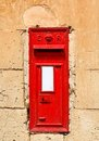 Traditional red english letterbox mounted in a dry stone wall Stock Photo