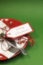Traditional red and green merry christmas dinner or lunch table place setting vertical with copy space for your text here Stock Photos