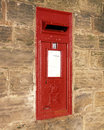 Traditional red Royal Mail post box Royalty Free Stock Photo