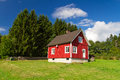 Traditional red Swedish house at the forest Stock Photo