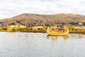 Traditional reed boat lake titicaca peru puno uros south america floating islands natural layer about one to two meters thick that Stock Image