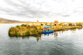 Traditional reed boat lake titicaca peru puno uros south america floating islands natural layer about one to two meters thick that Stock Images