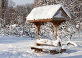 Traditional resting place in snow - RAW format Stock Image