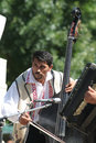 Traditional romanian musician a double bass player at a fair in bucharest Stock Image