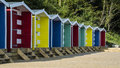 Traditional row of colourful beach huts located at freshwater isle wight Stock Photos