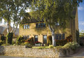 Traditional rural homes scene and immaculate gardens Stock Photography