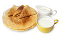 Traditional russian pancakes with sour cream and milk isolated on white background Royalty Free Stock Image