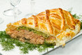 Traditional salmon in puff pastry with spinach and zucchini Stock Photo