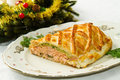 Traditional salmon in puff pastry with spinach and zucchini christmas table Stock Photography