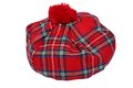 Traditional Scottish Red Tartan Bonnet. Royalty Free Stock Photo