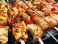 Traditional shish kebab prepared on coals Royalty Free Stock Photography