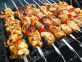 Traditional shish kebab prepared on coals Royalty Free Stock Image
