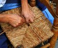 Traditional spain reed chair handcraft man hands Stock Photography