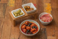 Traditional Spanish tapas: chorizo, ham and olives Stock Photos