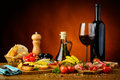 Traditional spanish tapas and red wine still life with Royalty Free Stock Images