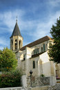 Traditional stone church with steeple in france gothic catholic place of worship building pointy and masonry walls a small rural Royalty Free Stock Photography