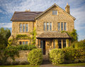 Traditional stone home picturesque build family fronted by lushious garden Stock Photos