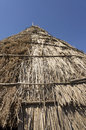 Traditional straw hut in greek country Royalty Free Stock Photo