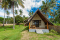 Traditional style accommodation on tropical island Stock Photography