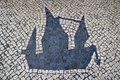 Traditional style portuguese calcada pavement for pedestrian area in macau china former colony the image shows colonial sail ships Royalty Free Stock Image