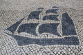 Traditional style portuguese calcada pavement for pedestrian area in macau china former colony the image shows large colonial sail Stock Photography
