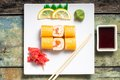 Traditional sushi rolls on white plate philadelphia with chopstick and wasabi top view Stock Photo