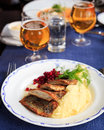 Traditional swedish dish with fried herring and mashed potatoes and lingon berries served with beer photographed with selective fo Royalty Free Stock Photos
