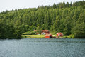 Traditional swedish house red at lake Stock Image