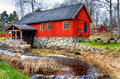 Traditional swedish watermill old in spring season Stock Photo