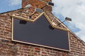 Traditional tavern pub sign public house or on side of old building blank for insertion of name Stock Photo