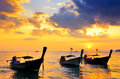Traditional thai boats at sunset beach Royalty Free Stock Photo