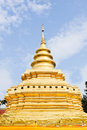 Traditional Thai golden pagoda in Northern style. Stock Photo