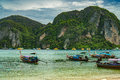 Traditional Thai Longtail boats and new speed boats on Phi Phi island, Thailand Royalty Free Stock Photo