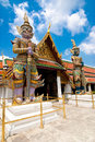 Traditional thai style statue of guard at wat phra kaeo temple emerald buddha in grand royal palace most important buddhist Stock Photos