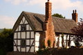 Traditional thatched cottage photograph of a house in england Stock Image