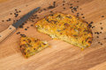 Traditional turkish corn bread with anchovy on a wooden surface Stock Photos