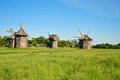 Traditional Ukrainian historical windmills at museum of Ukrainian national architecture in Pirogovo village Royalty Free Stock Photo