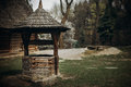 Traditional ukrainian water well, rustic old wooden well in a fa Royalty Free Stock Photo