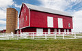 Traditional US red painted barn on farm Stock Images