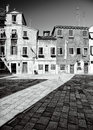 Traditional venetian courtyard houses and yard in black and white venice italy Royalty Free Stock Images