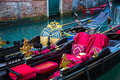 Traditional venice gondolas waiting for a romantic ride in the canals of Stock Photography