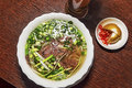 Traditional Vietnamese pho soup with meat and vegetables Royalty Free Stock Photo