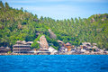 Traditional village on the sea with blue sky in thailand Royalty Free Stock Image