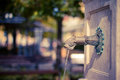 Traditional water fountain street and bokeh on a sunny afternoon Stock Photo