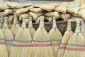 Traditional whisk brooms new on an open market Royalty Free Stock Images
