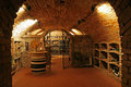 Traditional wine cellar interior with brick walls and ceiling Stock Photo