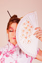 Traditional woman with a fan Stock Photos