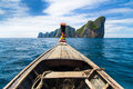 Traditional wooden boat approaching picture perfect tropical koh phi phi island thailand asia Royalty Free Stock Images