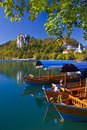 Traditional wooden boats in Bled Stock Photography